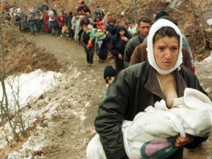 Albanian woman feeds her baby in the refugees colone -1999